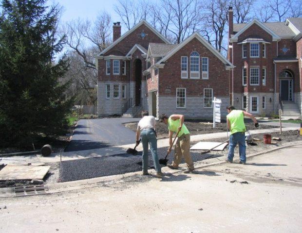 Jim George and Sons asphalt paving team hard at work.