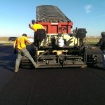Jim George and sons asphalt paving team.
